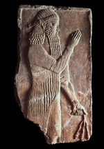 Assyrian Art - Priest with a branch of pomergranate tree. Detail of a relief from the palace of Assyrian king Sargon II