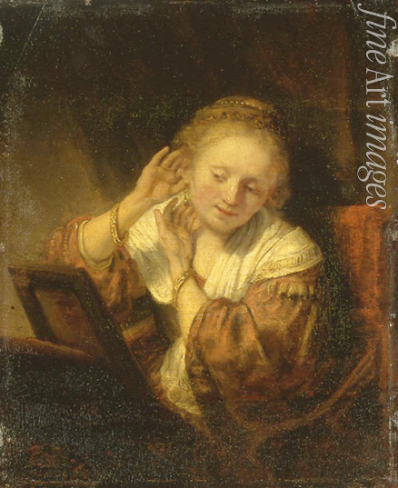 Rembrandt van Rhijn - Young Woman trying on Earrings